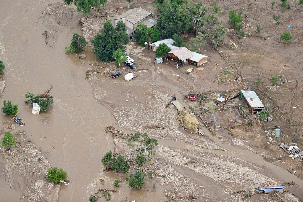 Description of . A house is seen surrounded by mud and debris, Saturday, Sept. 14, 2013, near Lyons. (Matthew Jonas/Times-Call)
