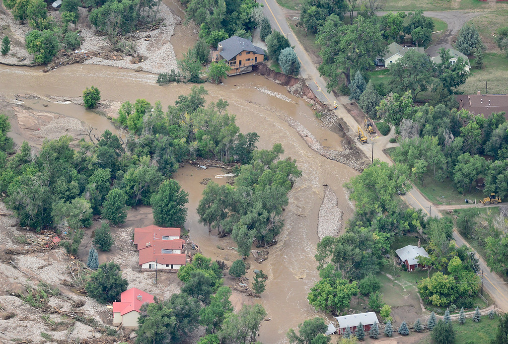 Description of . Homes damaged by flood water are seen, Saturday, Sept. 14, 2013, in Lyons. (Matthew Jonas/Times-Call)