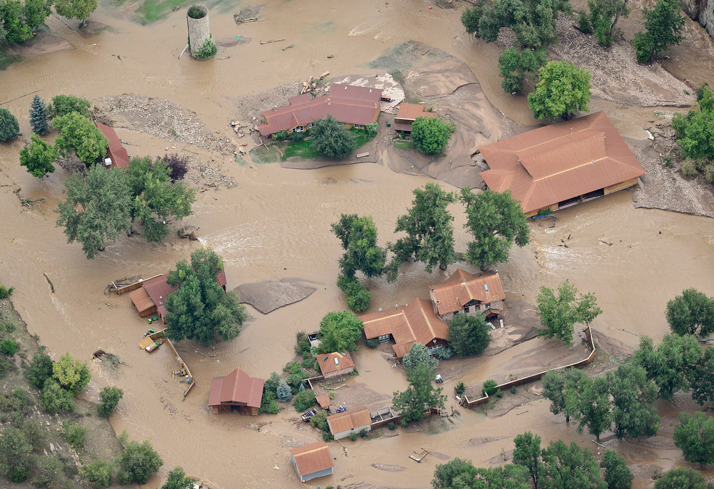 Description of . Floodwaters consume Planet Bluegrass, Saturday, Sept. 14, 2013, in Lyons. (Matthew Jonas/Times-Call)