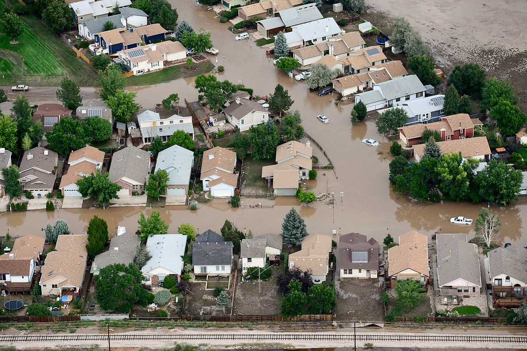 Description of . The flooded streets of Wade Road and Hayden Court are seen, Saturday, Sept. 14, 2013, in Longmont. (Matthew Jonas/Times-Call)