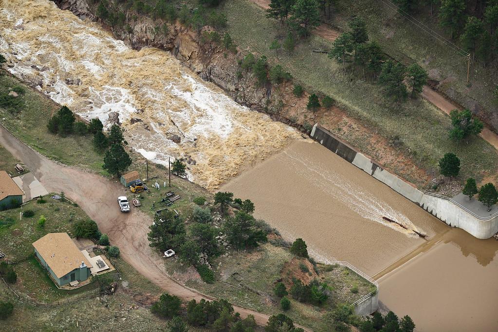 Description of . The emergency spillway is seen at Button Rock, Saturday, Sept. 14, 2013, near Lyons. (Matthew Jonas/Times-Call)
