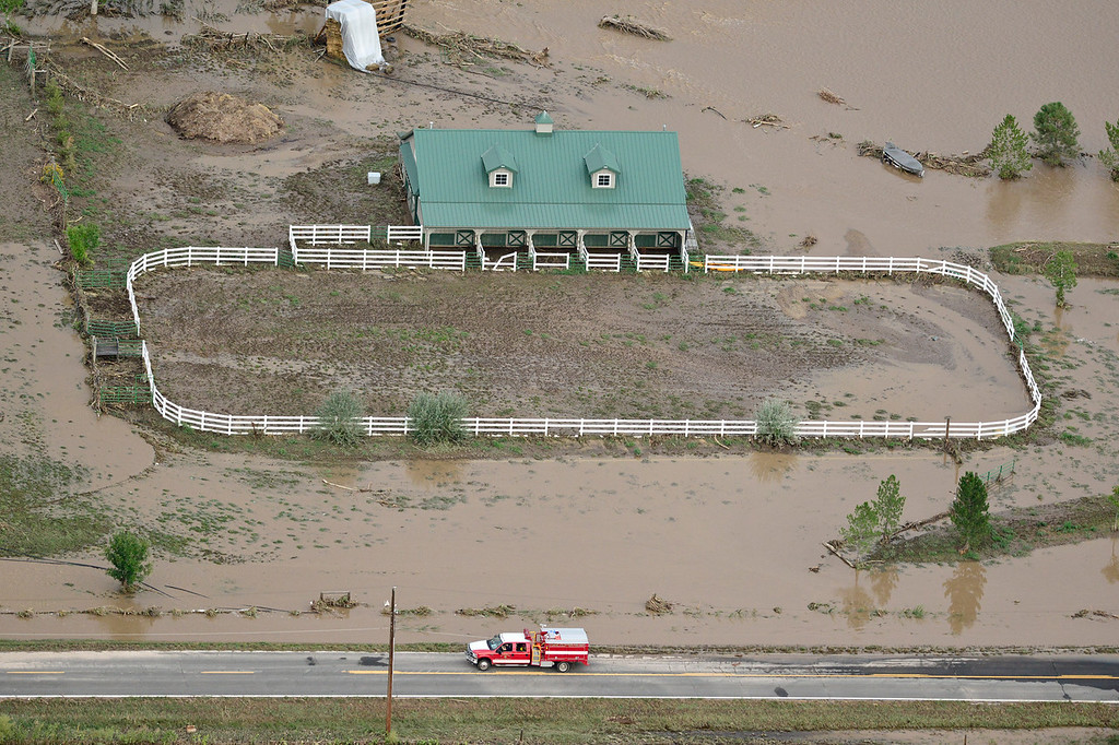 Description of . A stable is seen surrounded by flood water, Saturday, Sept. 14, 2013, near Hygiene. (Matthew Jonas/Times-Call)