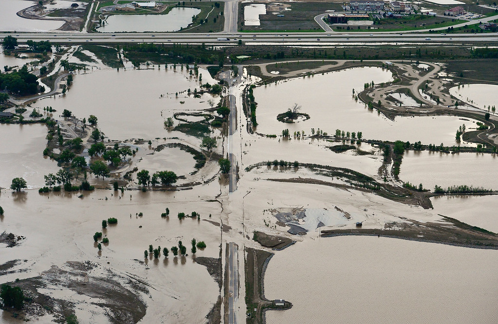 Description of . Flooding in St. Vrain State Park is seen, Saturday, Sept. 14, 2013, near  I-25 east of Longmont. (Matthew Jonas/Times-Call)