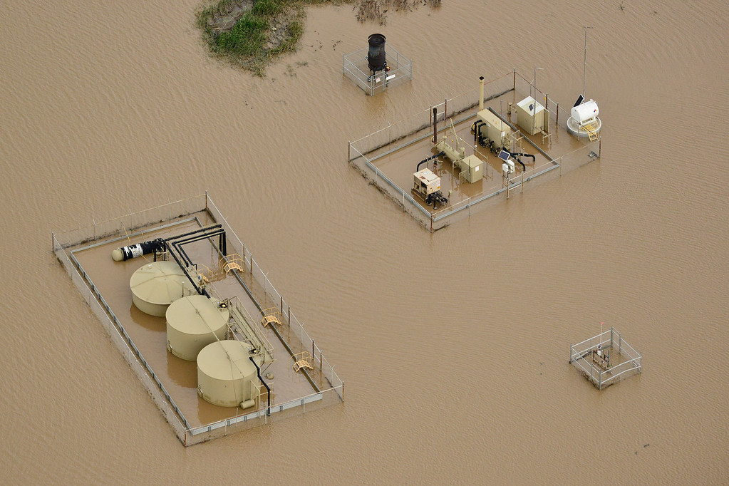 Description of . Oil and gas wells submerged in floodwater are seen, Saturday, Sept. 14, 2013, in Weld County. (Matthew Jonas/Times-Call)
