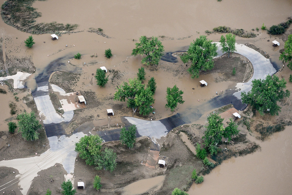 Description of . Flooded camp sites at St. Vrain State Park are seen, Saturday, Sept. 14, 2013, near Longmont. (Matthew Jonas/Times-Call)