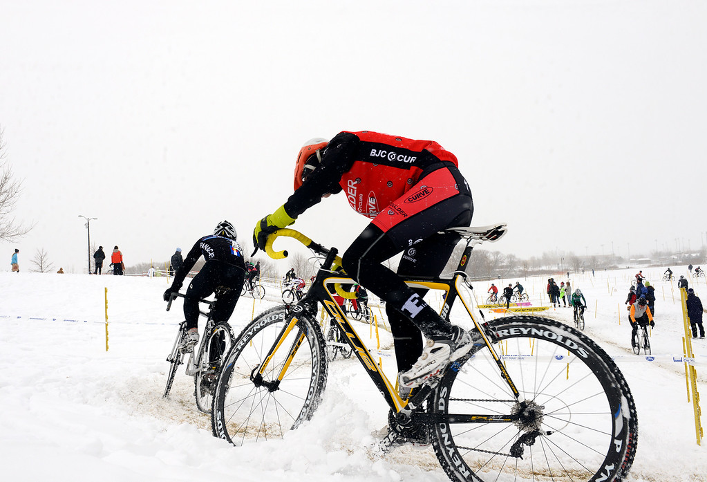 Description of . Racers battle the each other and the weather Saturday, January 04, 2014 during the Altitude Adjustment Cross cyclocross race at Sandstone Ranch. (Lewis Geyer/Times-Call)