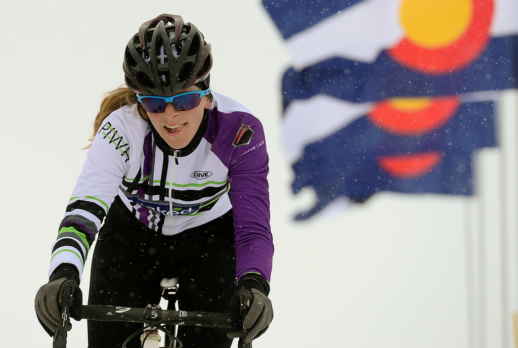 Description of . Emily Zinn, of Boulder, leads her race Saturday, January 04, 2014 during the Altitude Adjustment Cross cyclocross race at Sandstone Ranch. Zinn went on to win her Category 3 race. (Lewis Geyer/Times-Call)