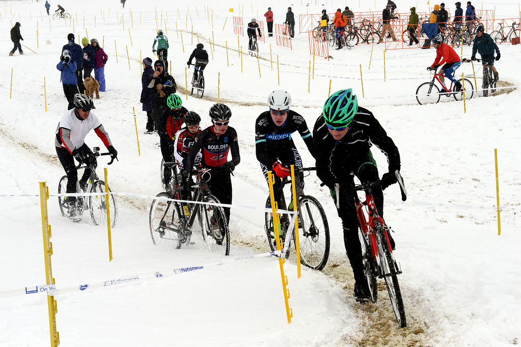 Description of . Riders make their way up a hill Saturday, January 04, 2014 during the Altitude Adjustment Cross cyclocross race this weekend at a snowy Sandstone Ranch. (Lewis Geyer/Times-Call)