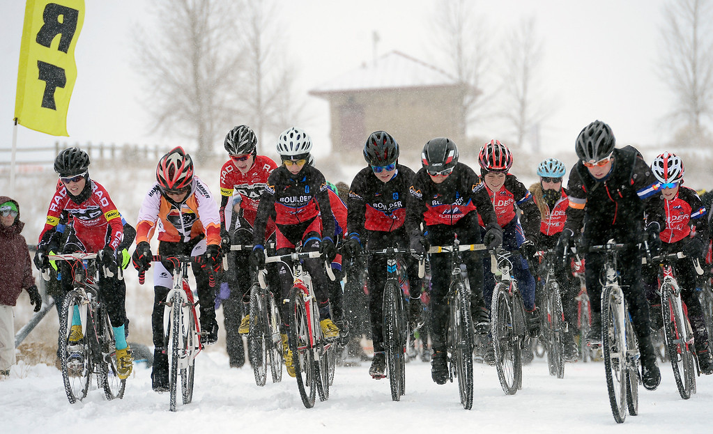 Description of . Juniors begin their race on a snowy Saturday, January 04, 2014 during the Altitude Adjustment Cross cyclocross event this weekend at Sandstone Ranch. (Lewis Geyer/Times-Call)