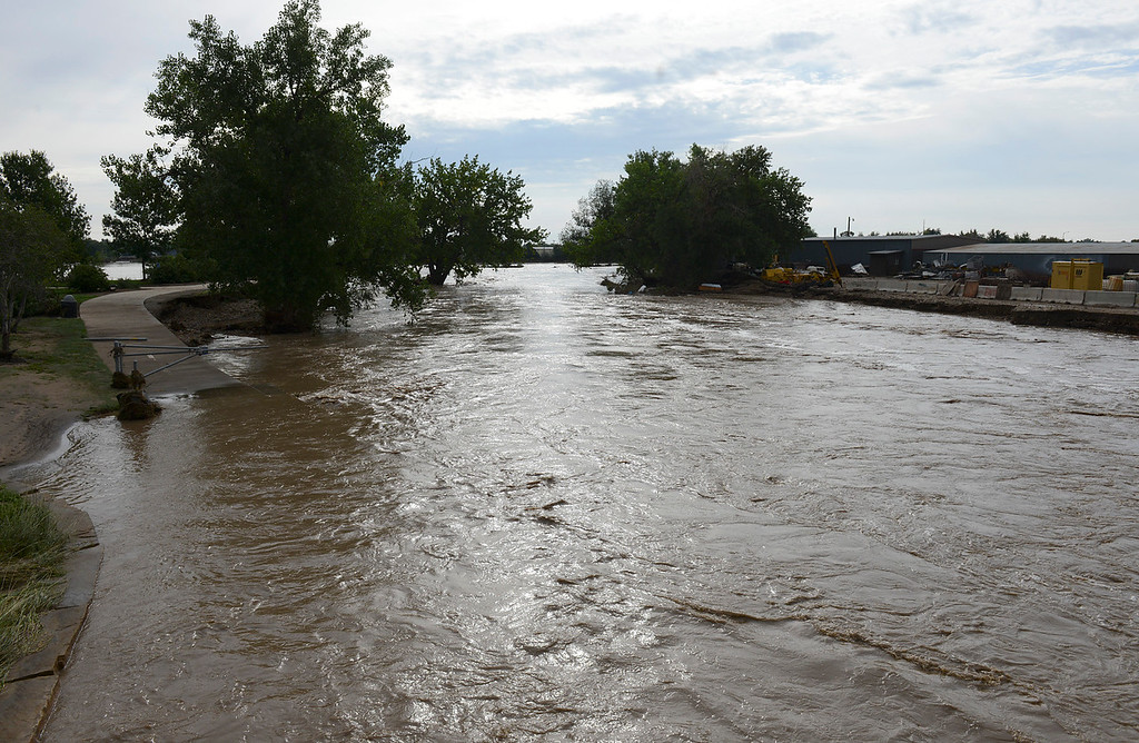 Description of . A swollen St. Vrain River at Izaak Walton Park Saturday morning, Sept. 14, 2013. (Lewis Geyer/Times-Call)
