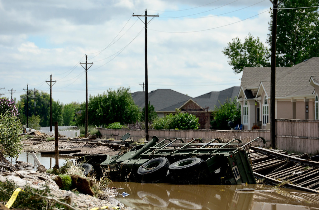 Description of . A M-923 troop transport vehicle is seen partially submerged off Twin Peaks Circle, Monday, Sept. 16, 2013, in Longmont.
