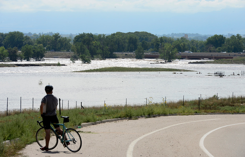 Description of . 20130913_FLOODING_LG_446.jpg Water pours through the swollen St. Vrain River at the East Frontage Road, north of Del Camino, Friday afternoon Sept. 13, 2013. (Lewis Geyer/Times-Call)