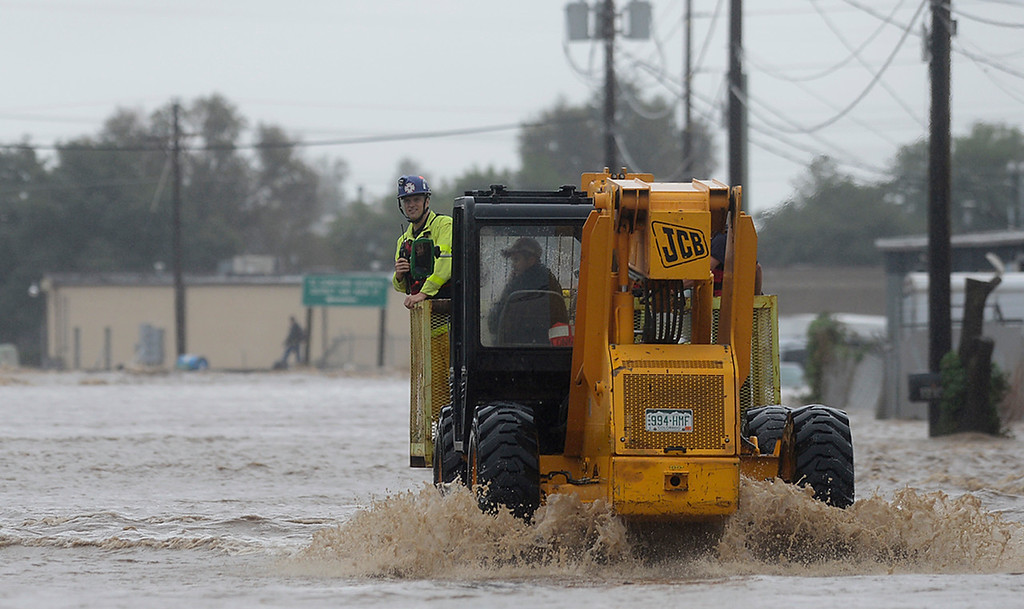 Description of . A forklift is used for rescue purposes on a flooded Boston Avenue Thursday Sept. 12, 2013. (Lewis Geyer/Times-Call)