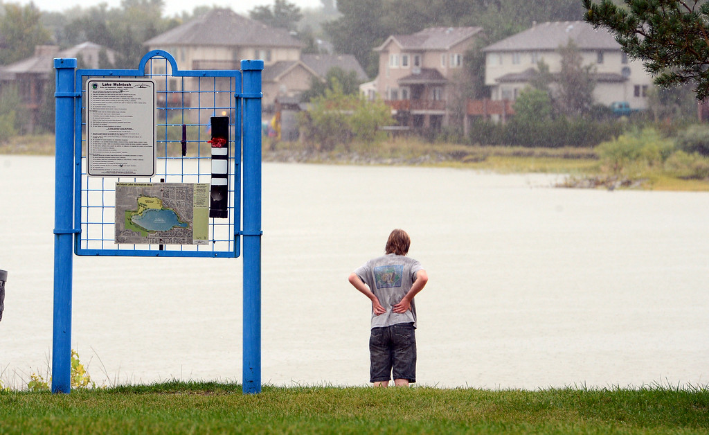 Description of . A  resident looks  over  McIntosh Lake Sunday afternoon in Longmont, Colorado on September 15, 2013.
