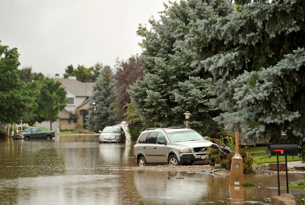 Description of . Flooding on Columbia Drive is seen, Sunday, Sept. 15, 2013, in Longmont.