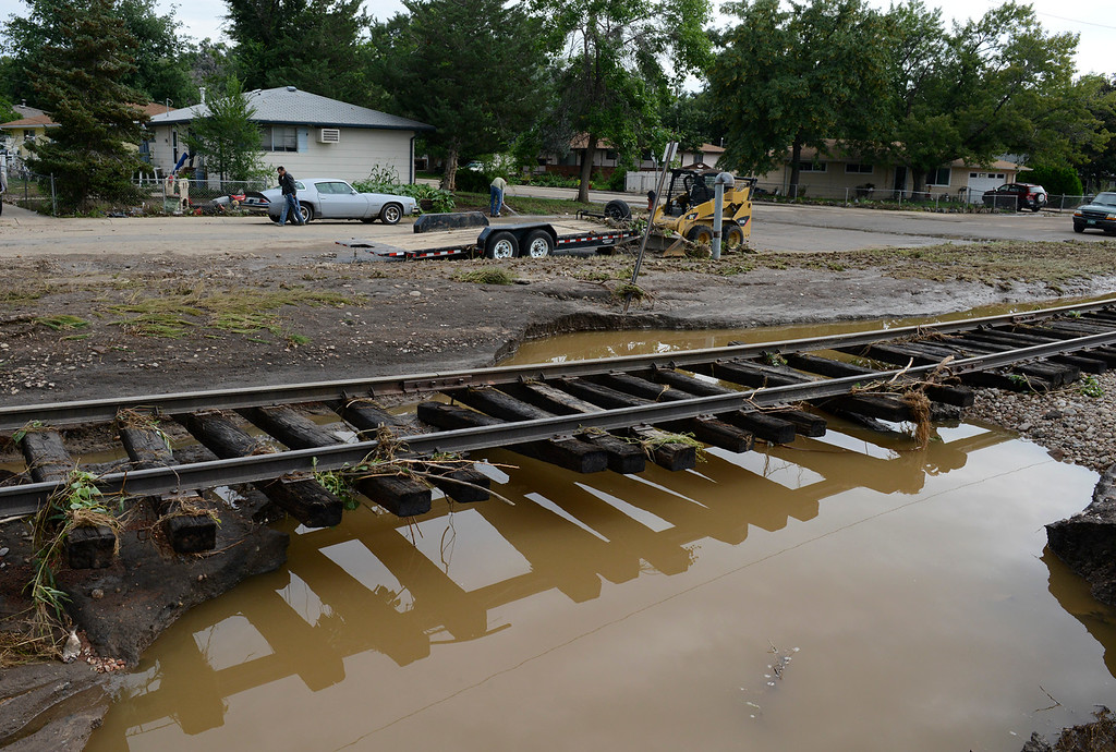 Description of . The washed-out railroad tracks along First Avenue in the Bohn Park neighborhood Saturday morning, Sept. 14, 2013. (Lewis Geyer/Times-Call)