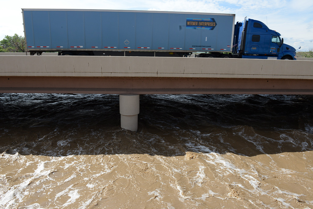Description of . 20130913_FLOODING_LG_212.jpg A swollen St. Vrain River rushes under I-25, north of Del Camino, Friday afternoon Sept. 13, 2013. (Lewis Geyer/Times-Call)