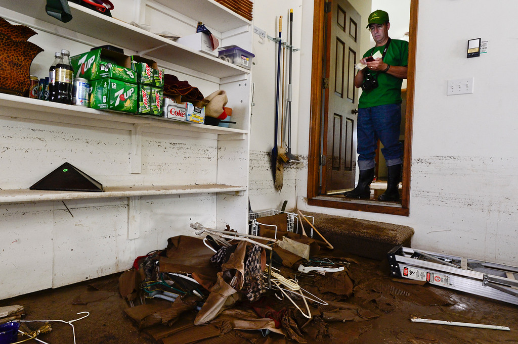 Description of . The flood water line is seen on the wall of Lou Belletire\'s garage on Twin Peaks Circle, Monday, Sept. 16, 2013, in Longmont. Belletire had water in both the basement on first floor of his home.