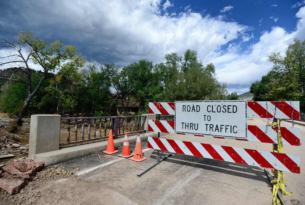 Description of . A road closed sign is seen blocking one lane of the 5th Avenue bridge near Evans Street, Wednesday, Sept. 18, 2013, in Lyons.