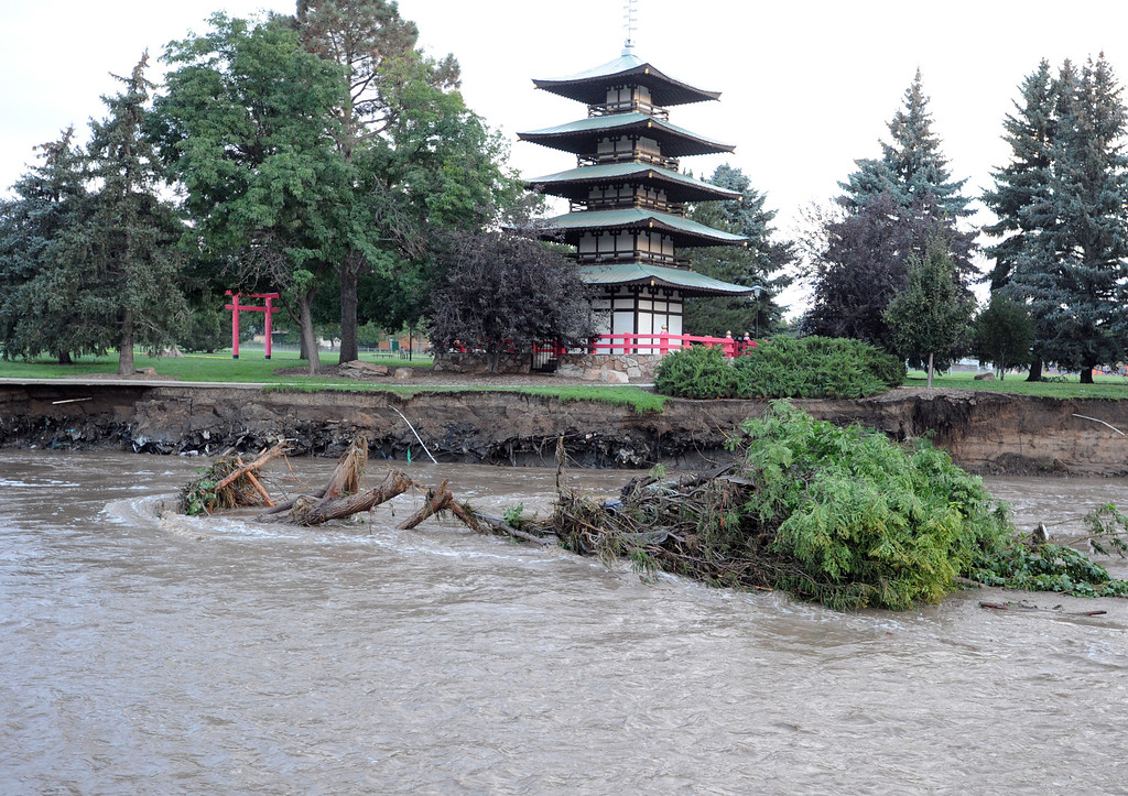Description of . The pagoda at Kanemoto Park  appears to be spared from the flood waters of Lefthand Creek in Longmont on September 14, 2013.