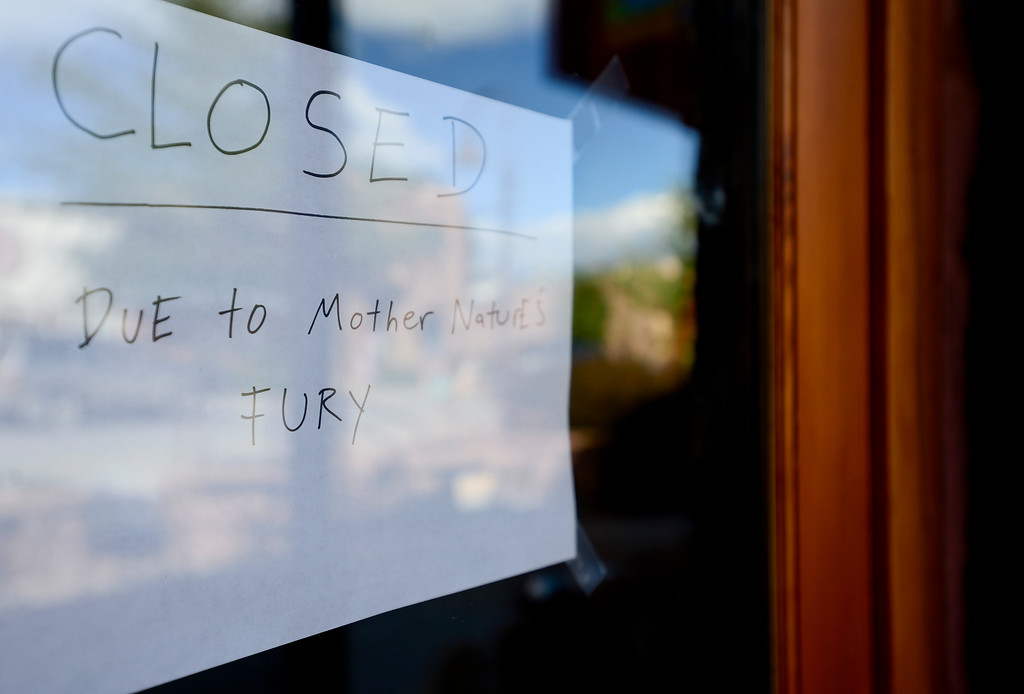 "Description of . A sign seen on the door at Barking Dog Cafe reads ""closed due to mother nature\'s fury,\"" Wednesday, Sept. 18, 2013, in Lyons.