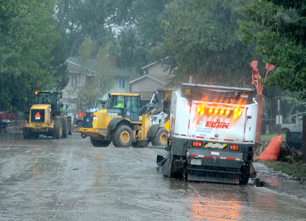 Description of . City crews work to clean up the mud on S Bowen Street at Lefthand Creek in Longmont, Colorado on September 15, 2013.