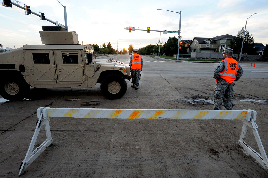 Description of . National Guard troops stationed at  S. Main Street and Missouri at sunrise of Saturday morning. The guards wouldn\'t give names.