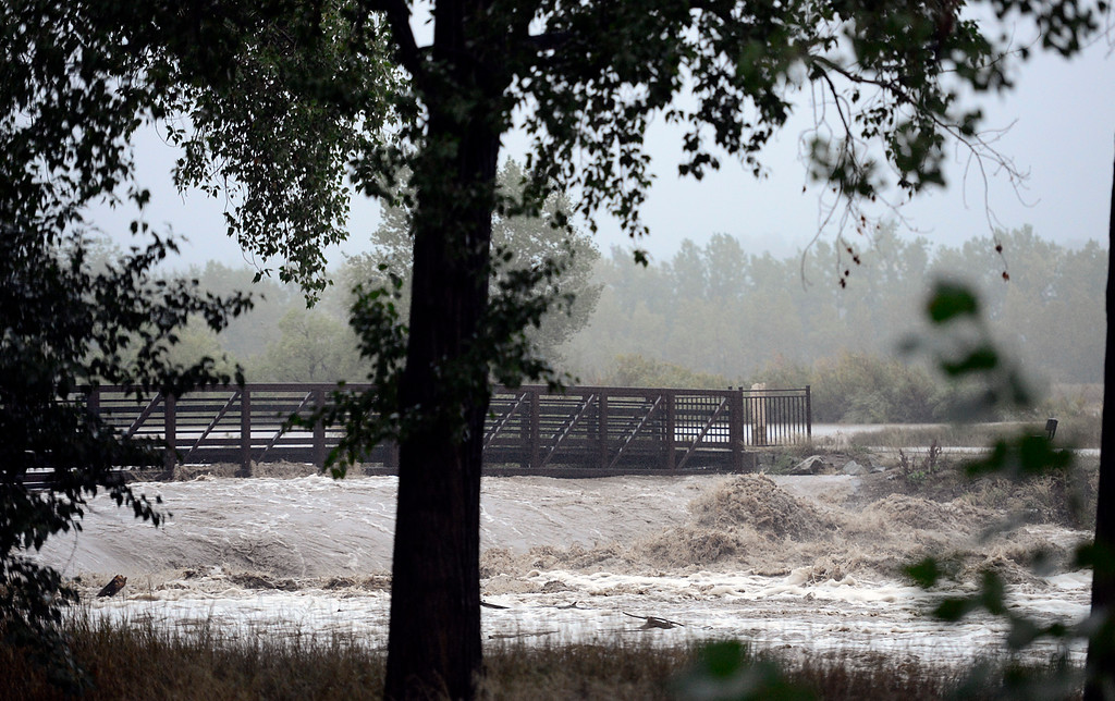 Description of . Dam behind Best Buy along flooded St. Vrain River, along Greenway, Thursday morning Sept. 12, 2013. (Lewis Geyer/Times-Call)