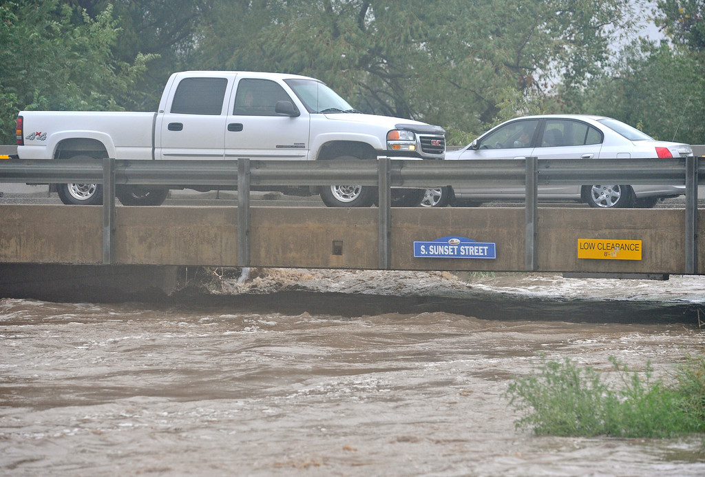 Description of . Vehicles pass over St. Vrain River on South Sunset St., Thursday, Sept. 12, 2013, in Longmont.