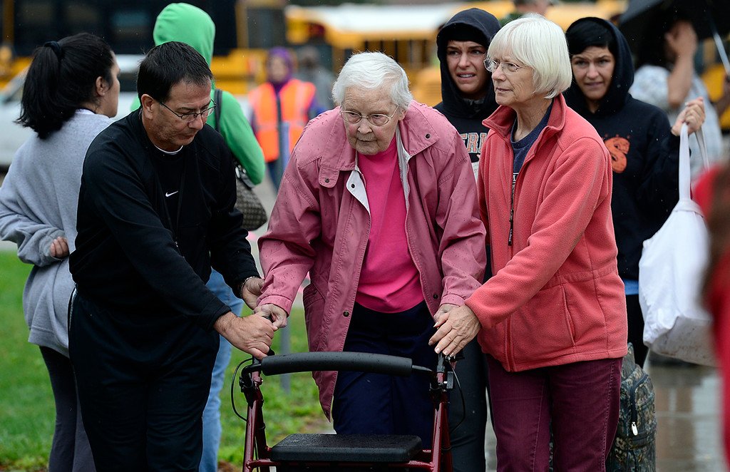 Description of . Lyons evacuaee Lorraine Self, 86 gets assistance at LifeBridge Church 9:30 a.m. Friday Sept. 13, 2013. (Lewis Geyer/Times-Call)