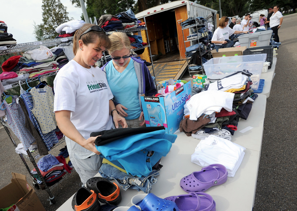 Description of . Liz Friedenson, left, and her daughter, Rachel, both of Colorado Friendship, sort clothes that are available to flood victims in Longmont, CO, on September 14, 2013. They are located at Roosevelt Park at Terry Street and LongsPeak.
