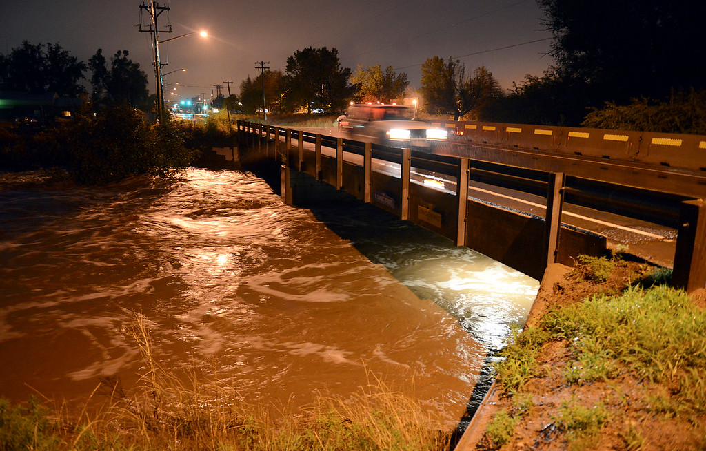 Description of . The St. Vrain River at S. Sunset Street about 6 a.m. Thursday, Sept. 12, 2013. (Lewis Geyer/Times-Call)