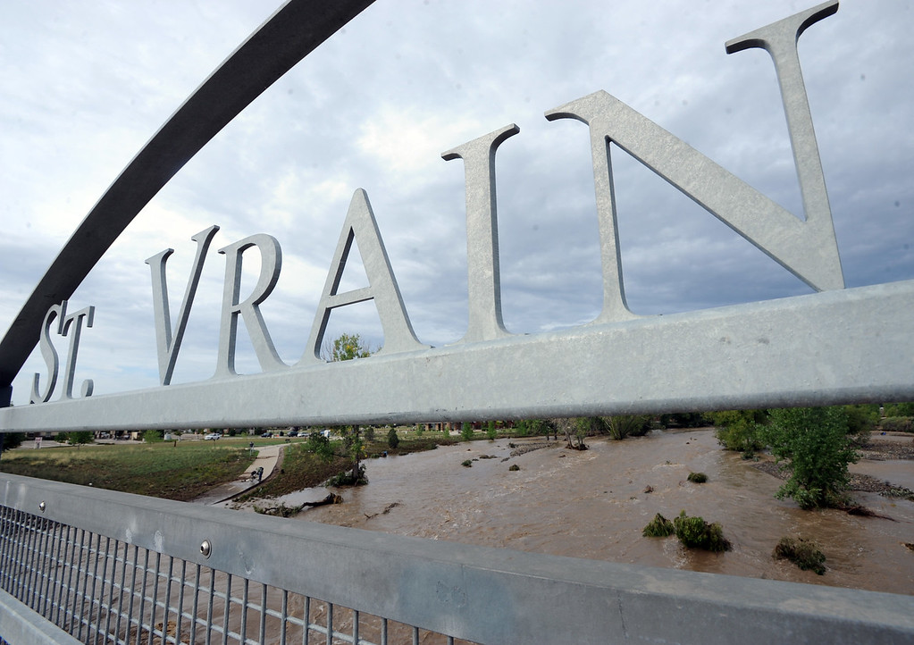 Description of . The flooded St Vrain river seen from the Martin Street bridge on the morning of September 14, 2013.