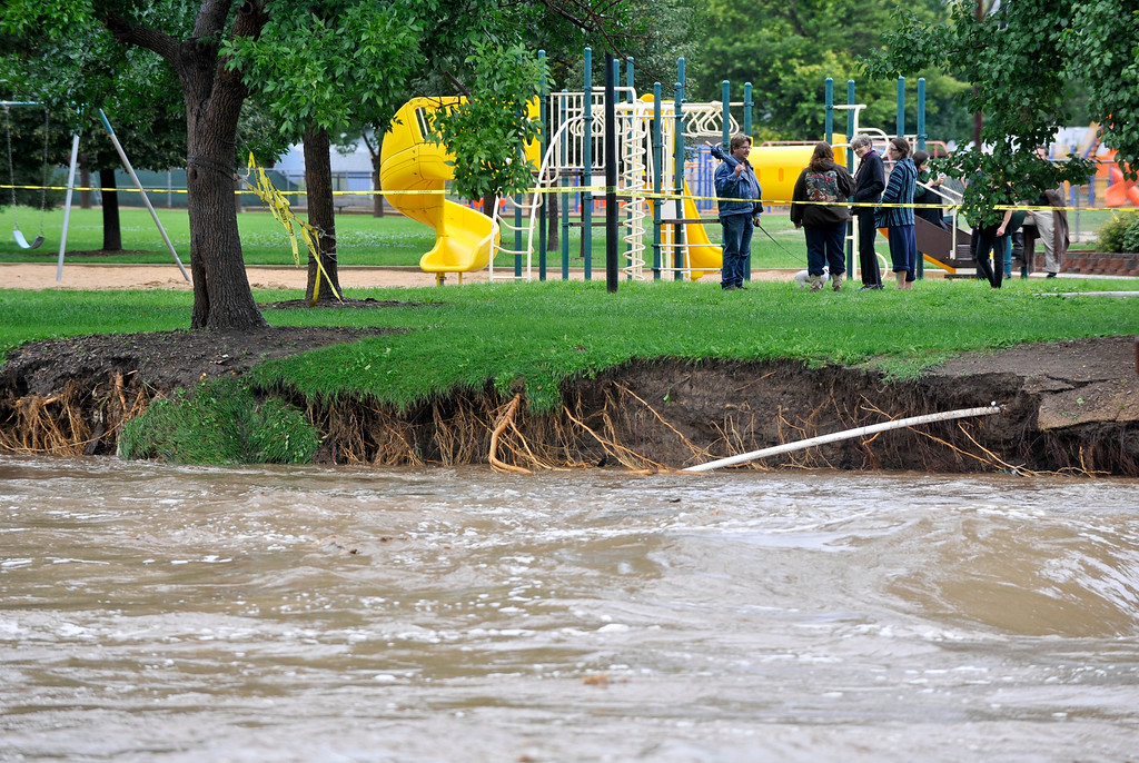 Description of . Damage from St. Vrain Creek flooding is seen near Kanemoto Park, Friday, Sept. 13, 2013, in Longmont.