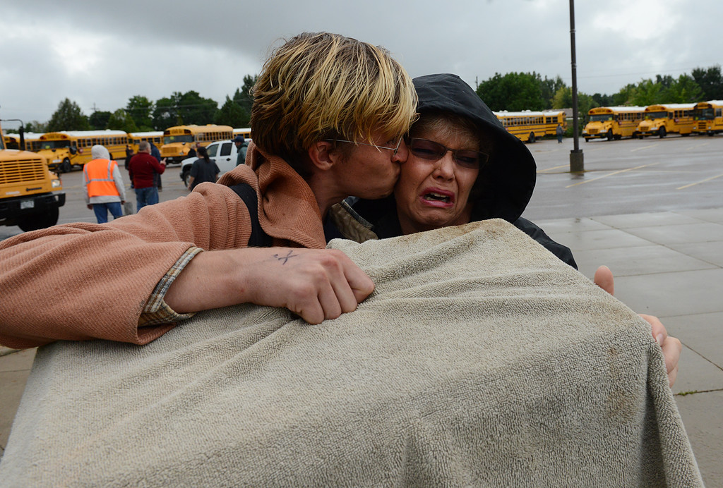 Description of . Janice Wheeler cries as she greets her son Nathan Wheeler at LifeBridge Church Friday morning Sept. 13, 2013 after Nathan was evacuated from Lyons. (Lewis Geyer/Times-Call)