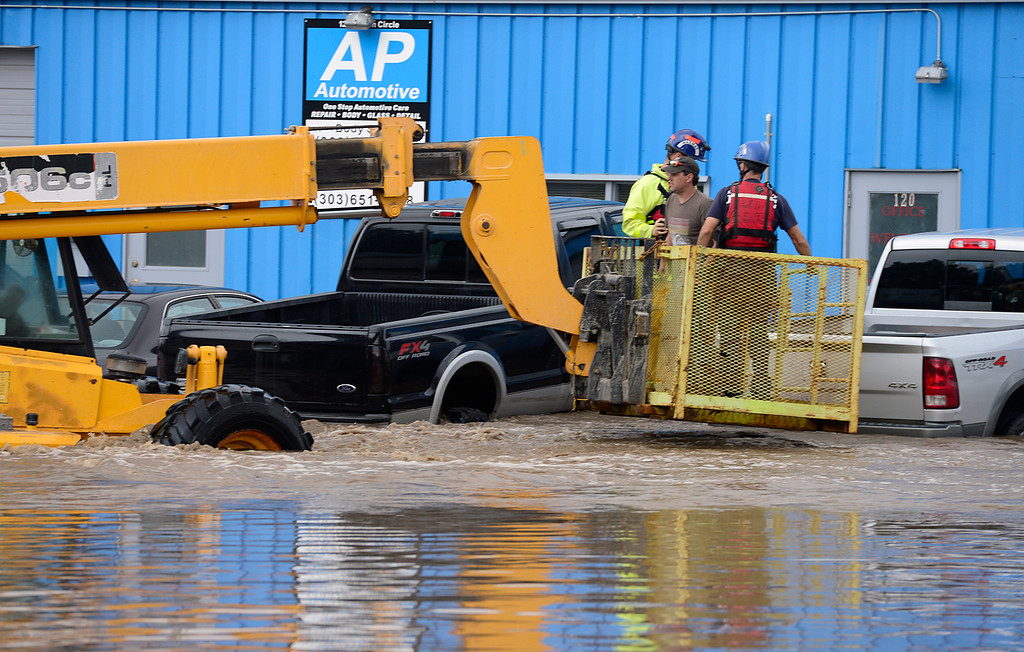 Description of . A man is rescued from his pickup outside AP Automotive along Price Road Thursday Sept. 12, 2013. (Lewis Geyer/Times-Call)