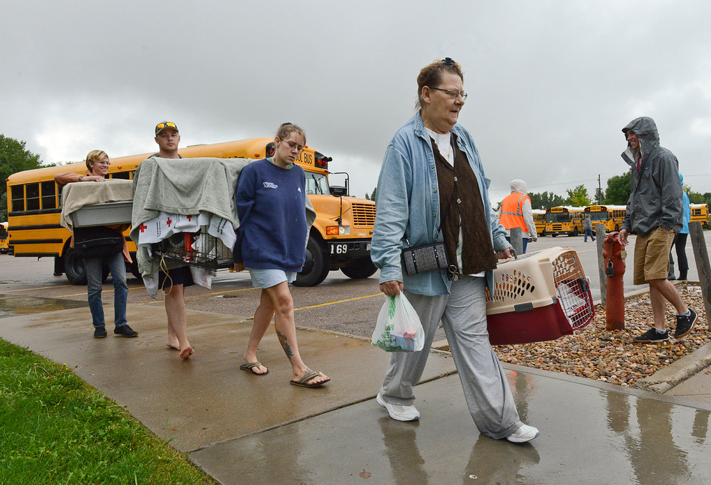 Description of . People evacuated from Lyons walk into LifeBridge Church Friday morning Sept. 13, 2013. (Lewis Geyer/Times-Call)