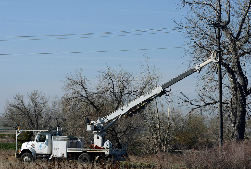 Description of . A Longmont Power Company truck braces a power pole at the scene of the railroad tie pile fire Thursday morning, April 17, 2014. (Lewis Geyer/Times-Call) TO VIEW A VIDEO AND SLIDESHOW VISIT WWW.TIMESCALL.COM