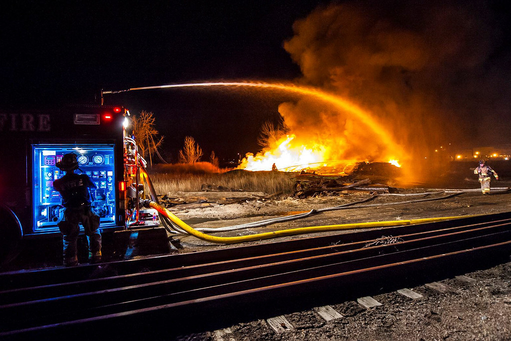 Description of . Longmont Fire Department pours water onto the burning railroad ties near the Longmont Wastewater Treatment Plant Wednesday night, April 16, 2014. (Photo courtesy Chris Rodgers)