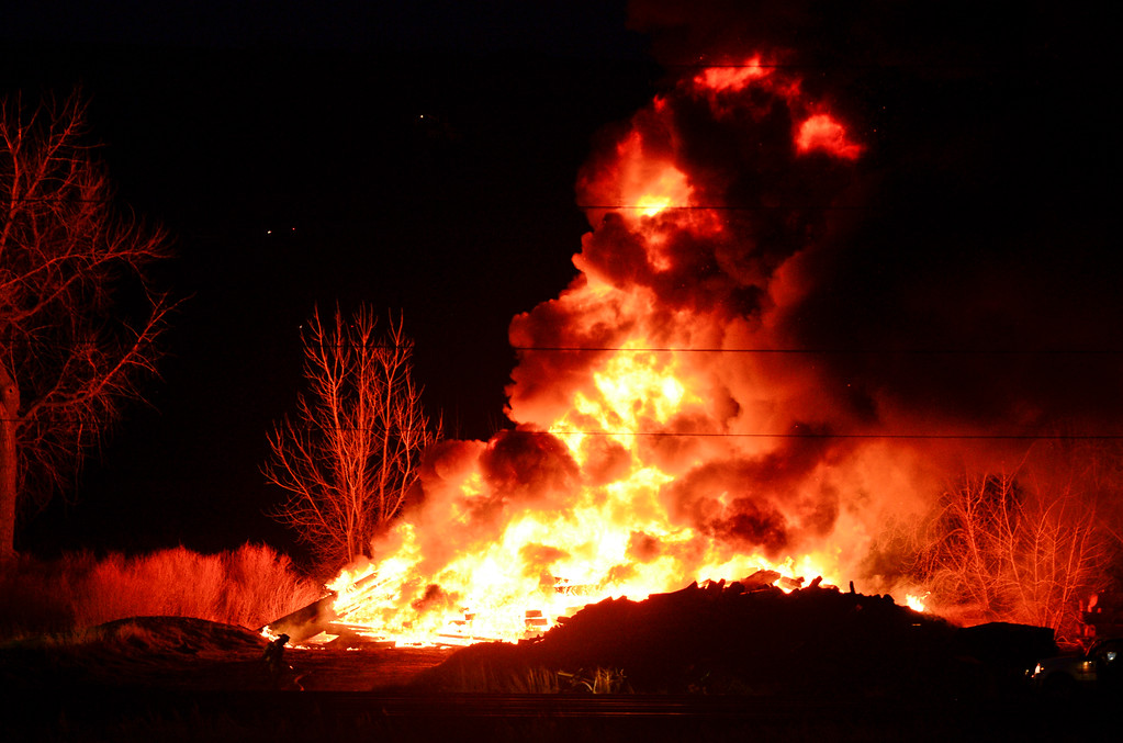 Description of . Flames from a railroad tie fire are seen, Wednesday, April 16, 2014, in Longmont. The cause of the fire is under investigation.  (Matthew Jonas/Longmont Times-Call)