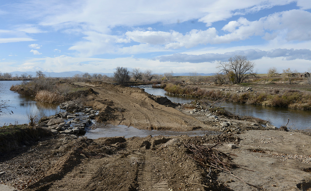 Description of . A breached area of Pelican Pond, left, still spills directly into the St. Vrain River in St. Vrain State Park Saturday Nov. 16, 2013. (Lewis Geyer/Times-Call)