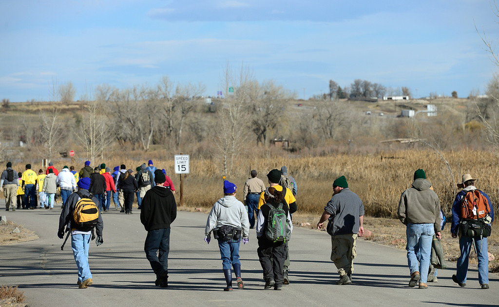 Description of . Volunteers walk to their assignments during at the start of a cleanup day at St. Vrain State Park Saturday Nov. 16, 2013. (Lewis Geyer/Times-Call)