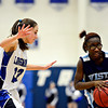 "Longmont's Kathryn Schell (23) pressures Vista PEAK's Aaliyah Carter during the game at Longmont High School on Tuesday, Feb. 26, 2013. Longmont beat Vista PEAK 65-18. For more photos visit  <a href=""http://www.BoCoPreps.com"">http://www.BoCoPreps.com</a>.<br /> (Greg Lindstrom/Times-Call)"