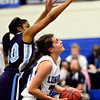 "Longmont's Dailyn Johnson, right, looks to shoot as Vista PEAK's Jaylynn Johnson defends during the game at Longmont High School on Tuesday, Feb. 26, 2013. Longmont beat Vista PEAK 65-18. For more photos visit  <a href=""http://www.BoCoPreps.com"">http://www.BoCoPreps.com</a>.<br /> (Greg Lindstrom/Times-Call)"