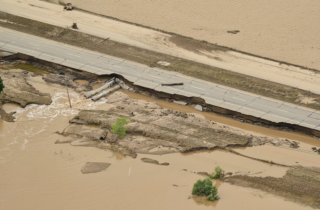 . A damaged section of Highway 119 is seen, Saturday, Sept. 14, 2013, east of Longmont. (Matthew Jonas/Times-Call)