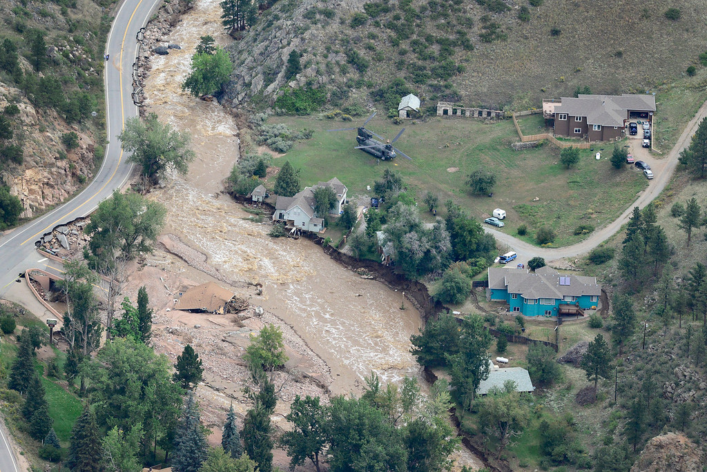 . A Colorado National Guard chinook helicopter is seen helping to evacuate residents from Lyons, Saturday, Sept. 14, 2013. (Matthew Jonas/Times-Call)