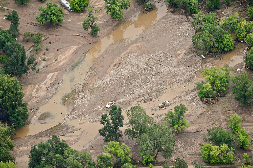 . Cars and debris are seen in the flood water and mud, Saturday, Sept. 14, 2013, in Lyons. (Matthew Jonas/Times-Call)