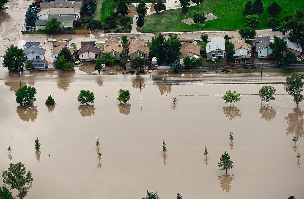. Flooded homes are seen near 9th Avenue by Twin Peaks Golf Course, Saturday, Sept. 14, 2013, in Longmont. (Matthew Jonas/Times-Call)