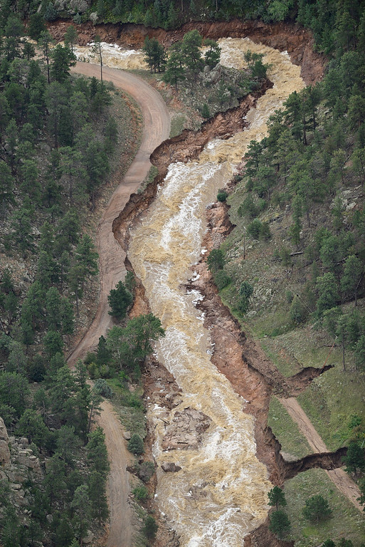 . Parts of County Road 80 to Button Rock are seen washed away, Saturday, Sept. 14, 2013, near Lyons. (Matthew Jonas/Times-Call)