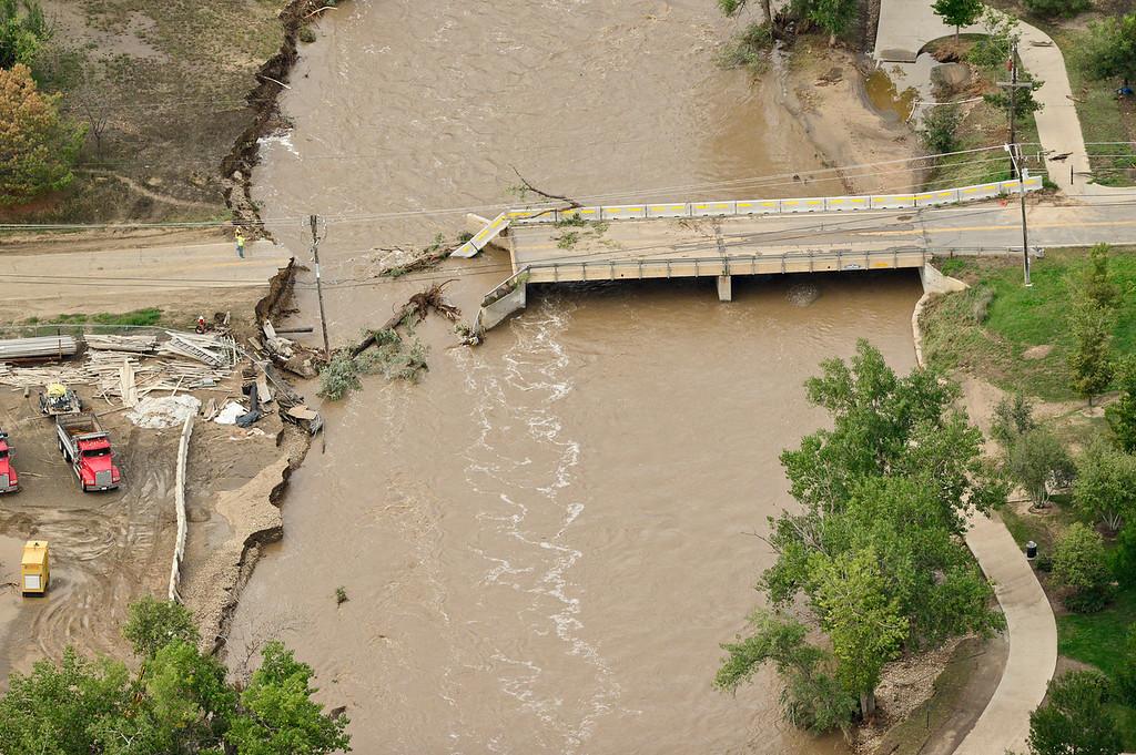 . A damaged Sunset Street bridge is seen, Saturday, Sept. 14, 2013, in Longmont. (Matthew Jonas/Times-Call)